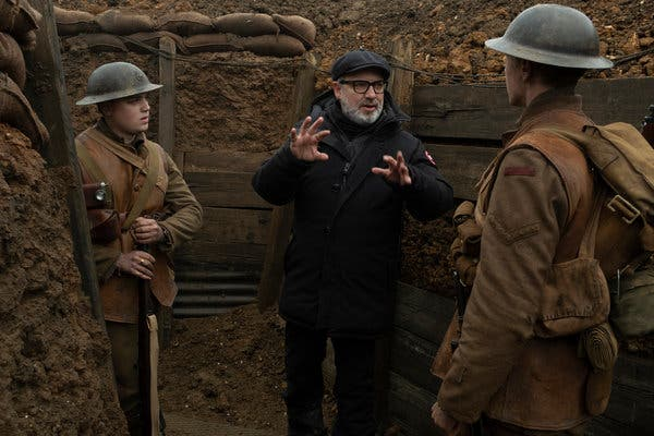 Director Sam Mendes (centre) with the leads, Dean Charles Chapman (left) and George MacKay (right)